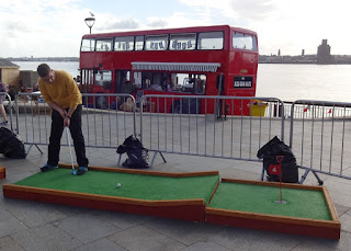 Crazy Golfing at the Pier Head in Liverpool on a summer pop-up course