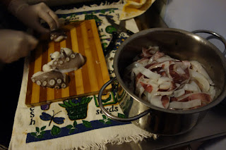 Octopus being chopped up for seafood soup Toscana Italia