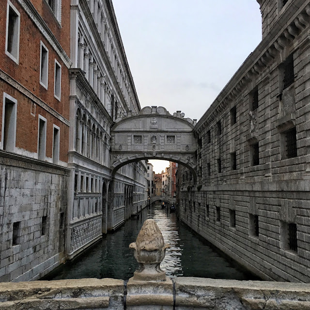 The bridge of sigs over a canal in Venice