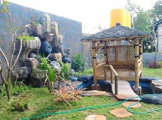 Taman dekorasi tebing dengan gazebo