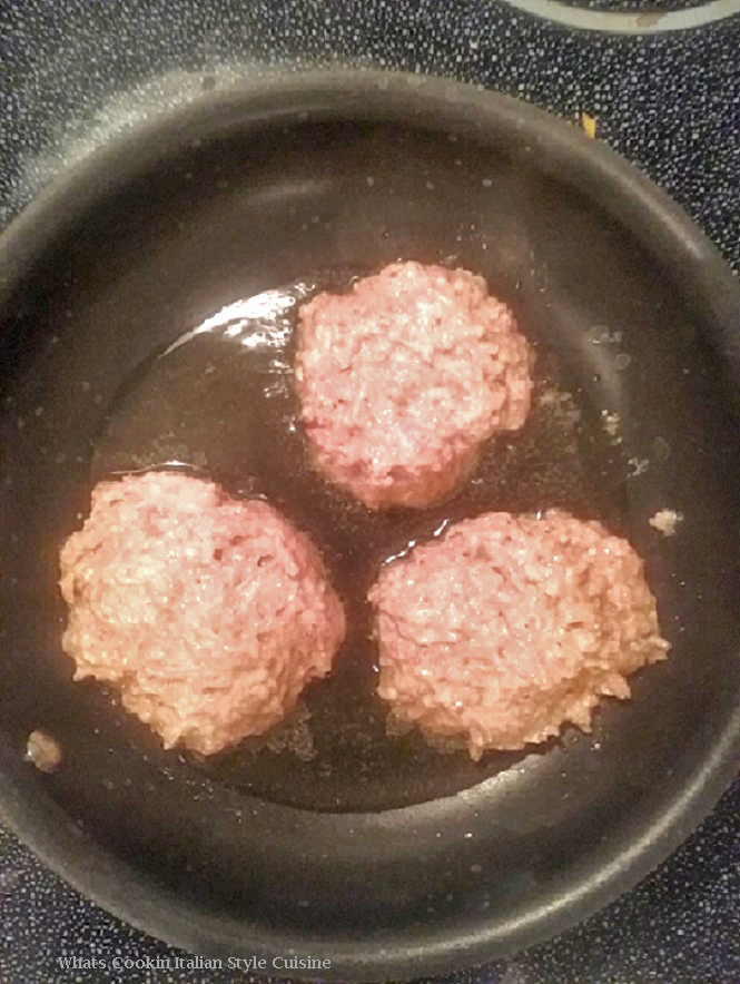 this is a photo of raw pork sausage mix shaped into a pattie form and in the fry pan about to be fried