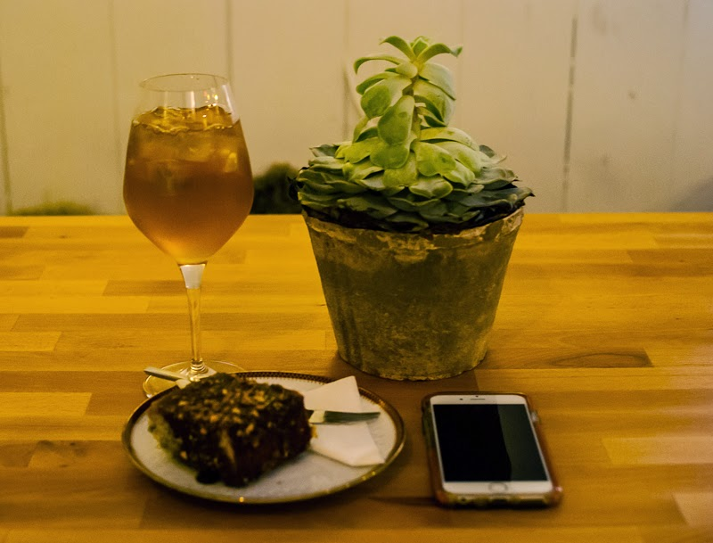 picture of banana cake and elderflower tea in cafe basement