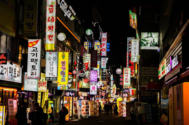 night time photograph of seoul korea with signage on a busy street