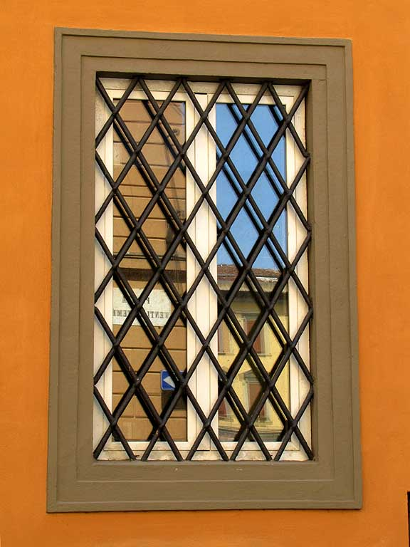 Reflections on a window with grate, Livorno