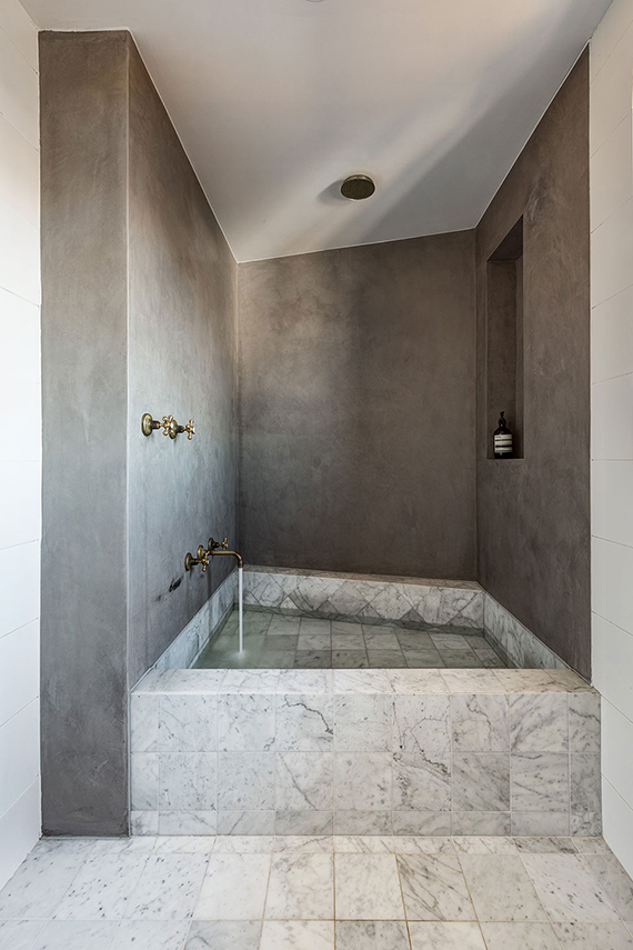 Enclosed built-in marble bathtub by Alexander & Co