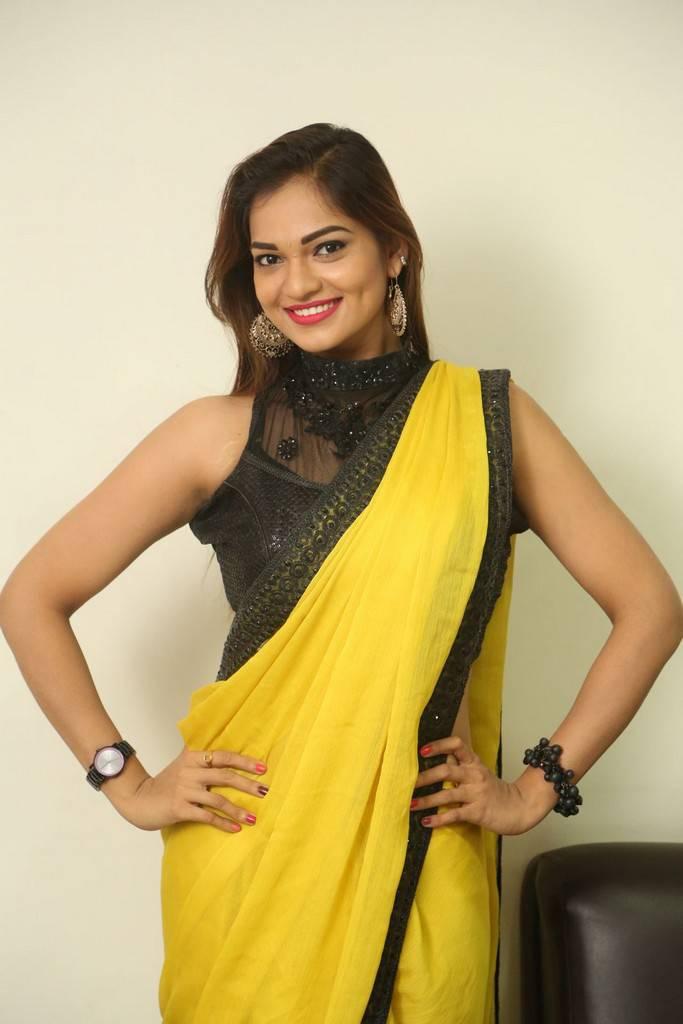 Telugu Girl Aswini Navel Hip Gallery In Transparent Yellow Saree