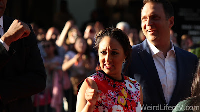 Tamera Mowry pointing towards the fans