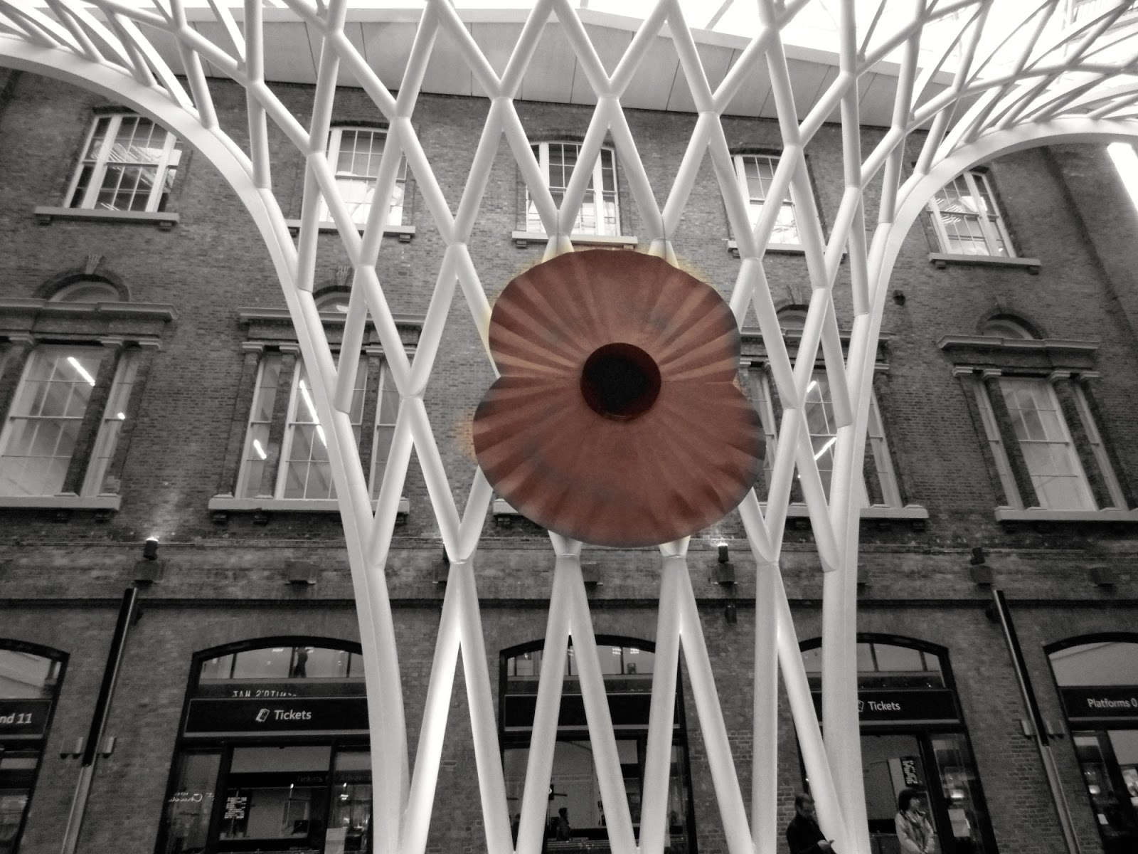 giant poppy at Kings Cross Station, London Remembrance Sunday