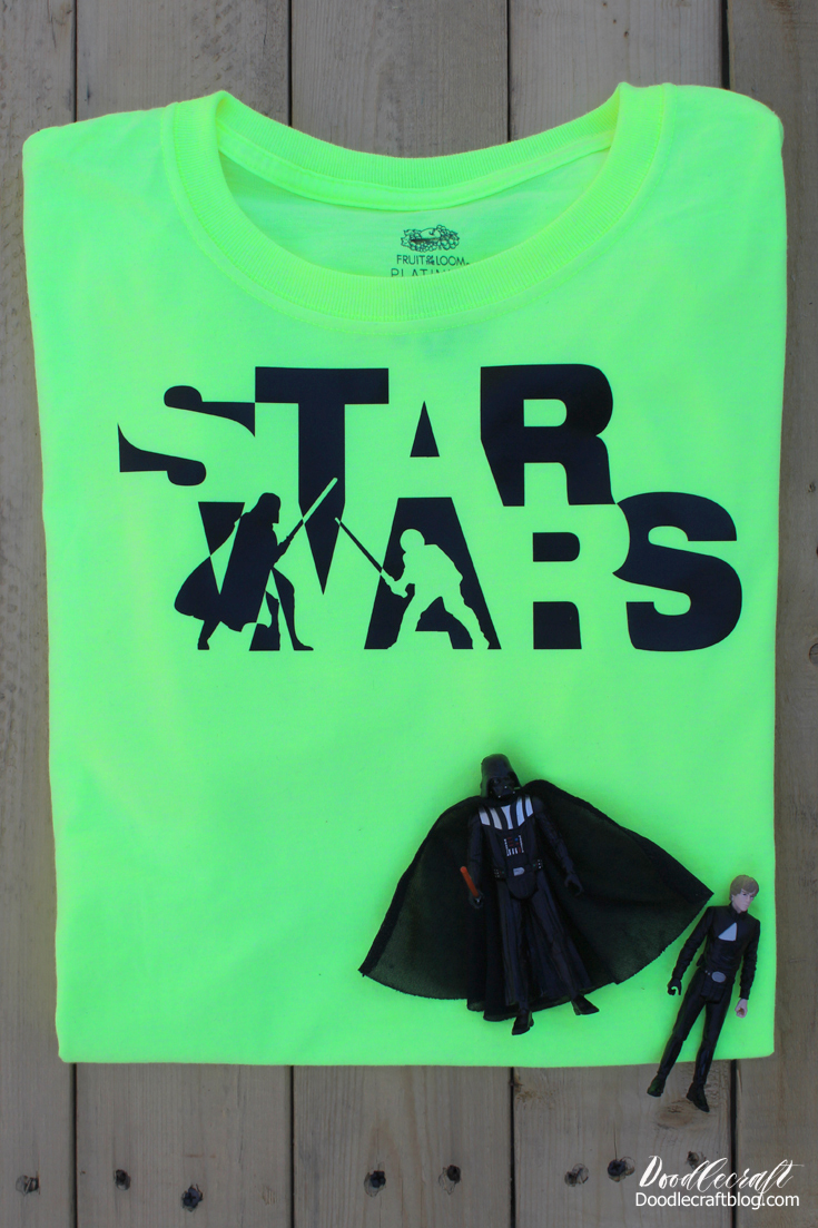 Neon green shirt with black star wars logo with darth vader and luke skywalker engaged in a lightsaber duel.
