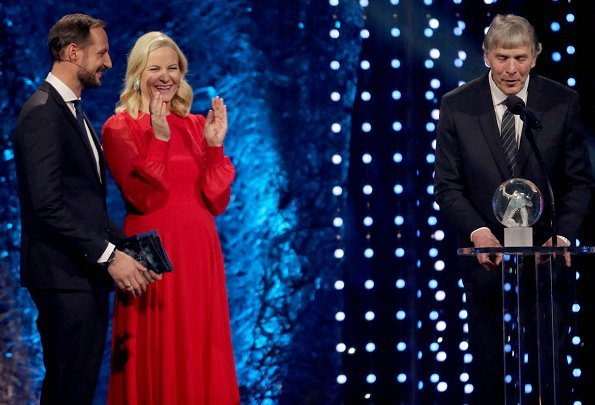 Crown Princess Mette-Marit wore red dress and  Nicholas Kirkwood Lace Pumps. at Olympic Amphitheater
