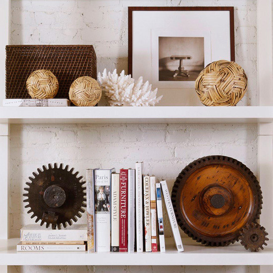 These shelves are adorned with natural elements like coral and rusted gears