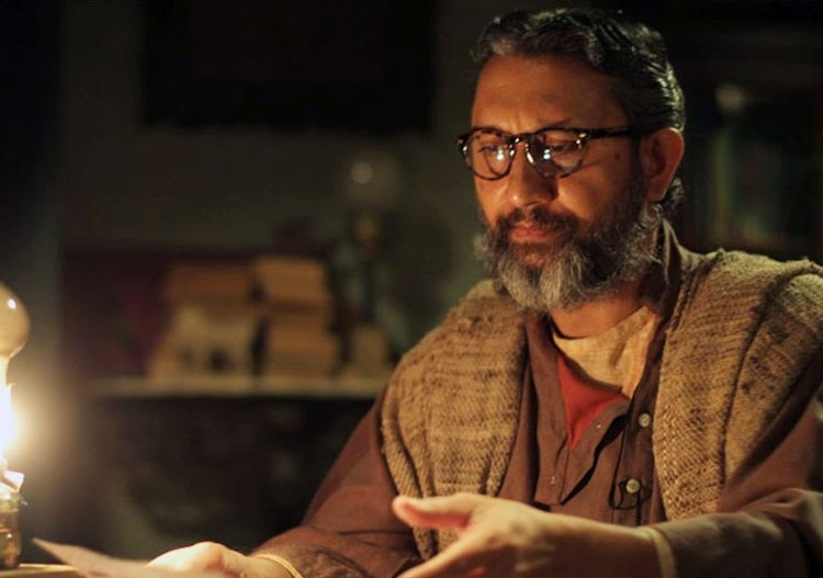 Neeraj Kabi as Dr. Guha, in Detective Byomkesh Bakshy! (2015), directed by Dibankar Banerjee