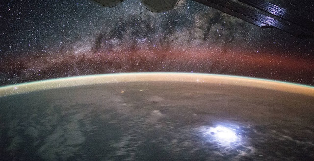 An image taken from the International Space Station shows orange swaths of airglow hovering in Earth's atmosphere. NASA's new Atmospheric Waves Experiment will observe this airglow from a perch on the space station to help scientists understand, and ultimately improve forecasts of, space weather changes in the upper atmosphere. Credits: NASA