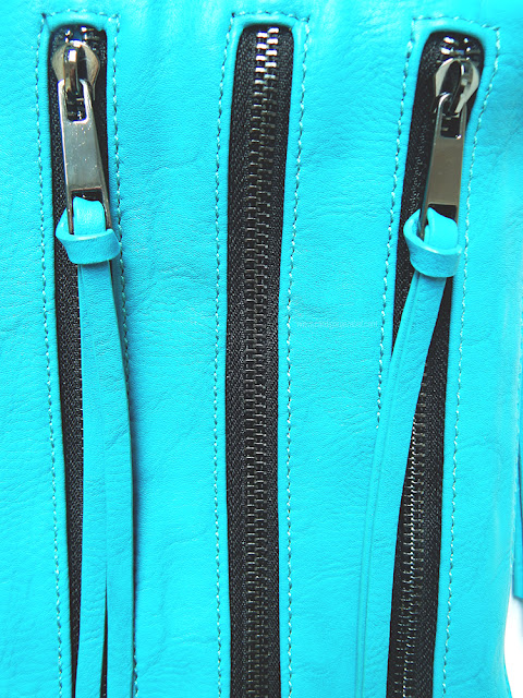 Blue bag with three zippers