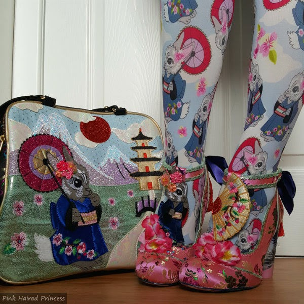 Irregular Choice kimono bunny handbag next to legs wearing matching tights and shoes