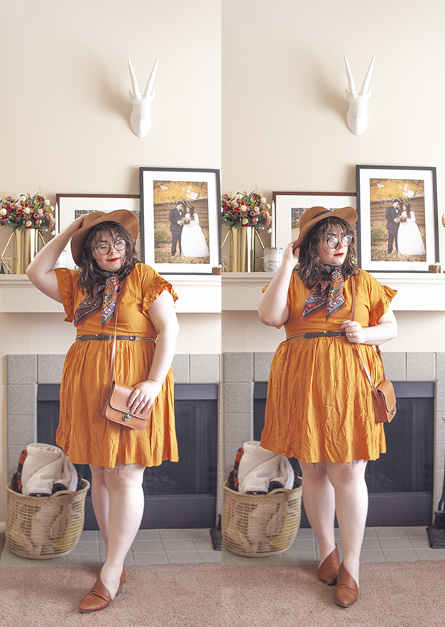An outfit consisting of a camel brown panama hat, a brick red patterned neck scarf, a mustardy yellow skater dress and brown d'orsay flats.