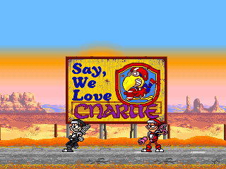 Captura con el final de Charlie Ninja, muestra a Roy y Lon junto a un cartel que dice Say, We Love Charlie