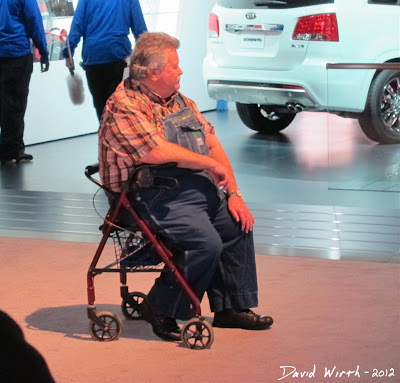 Fat Guy in Overalls at the Auto Show