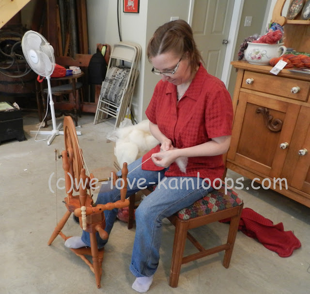 Rita Winning demonstrates how to make yarn on the spinning wheel