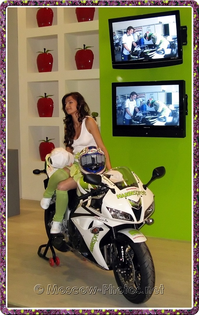 Girl on motor-bike at Photoforum - 2008, Moscow