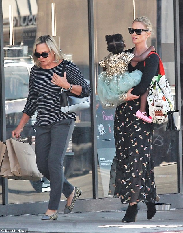 142c5f82200 Charlize Theron out shopping with her daughter and her mom.