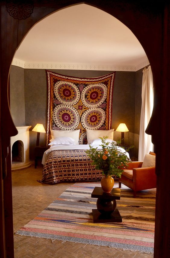 Moroccan bedroom. Love that tapestry