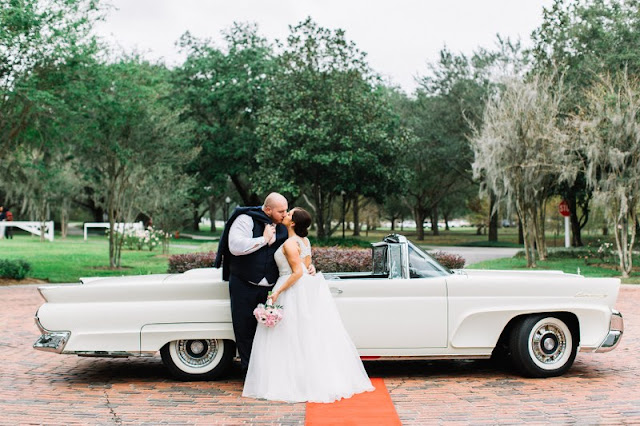 bride and groom send off in vintage car