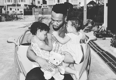 musician-flavour-with-his-kids-baby-girls-outside