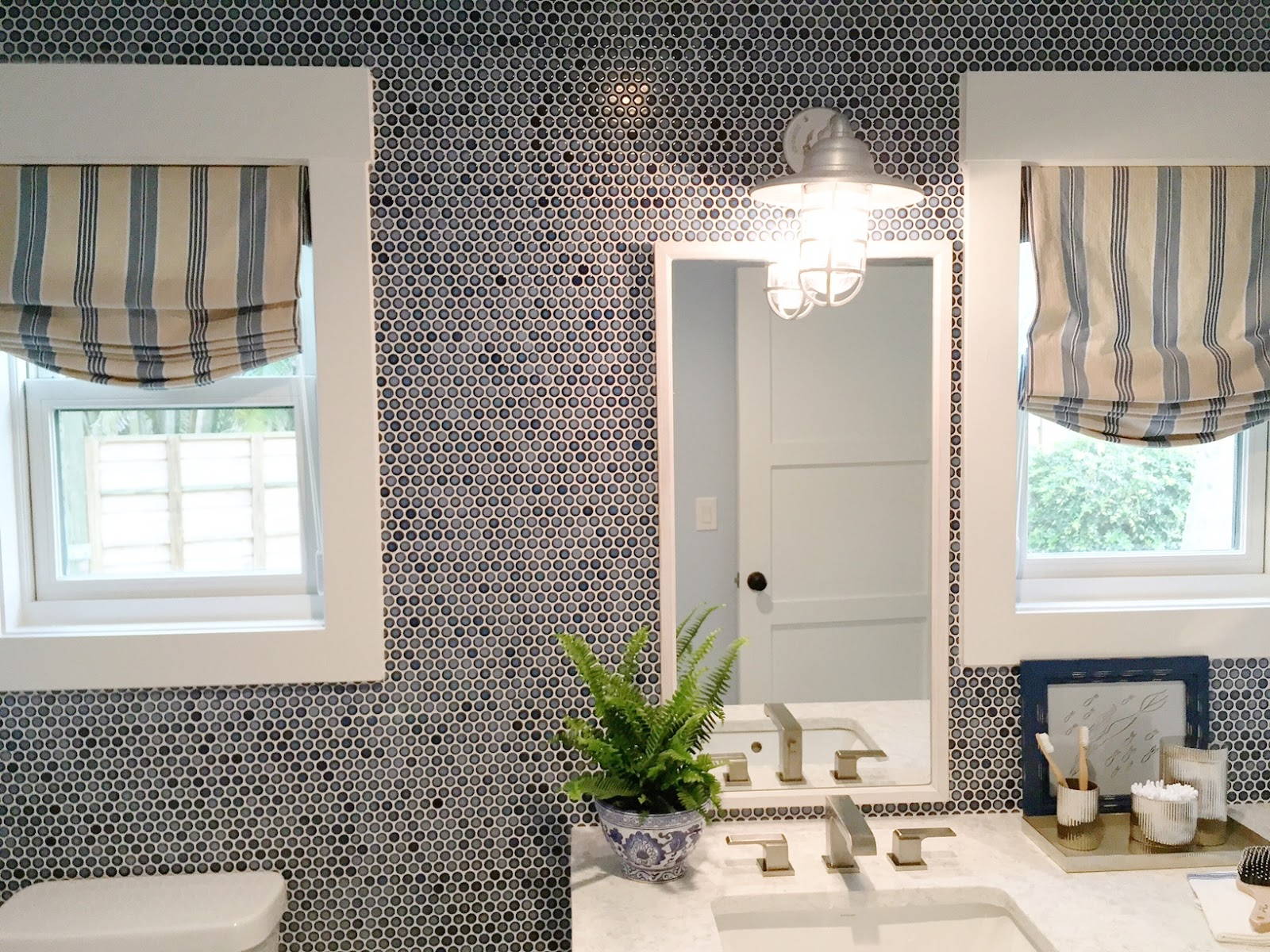 Popular Navy blue penny tile in bathroom