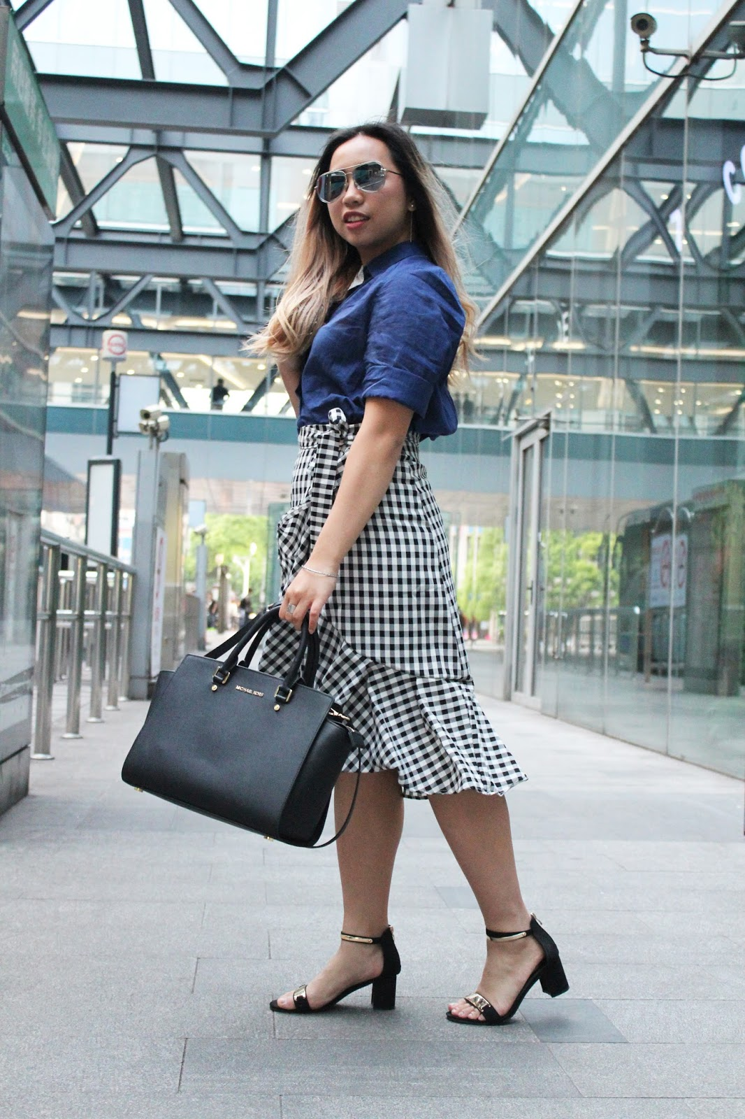 This is a photo of pairing gingham ruffled skirt piece with simple shirt from www.sidneyscarlett.com