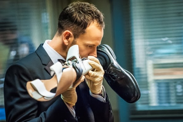 Jonny Lee Miller as Sherlock Holmes smelling and deducing from a prosthetic leg in CBS Elementary Season 2 Episode 13 All in the Family