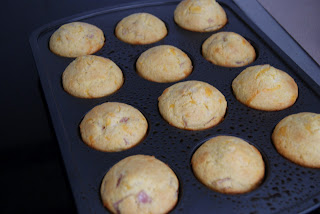 Crispy brown corn bread muffins fresh from the oven in a muffin baking pan.