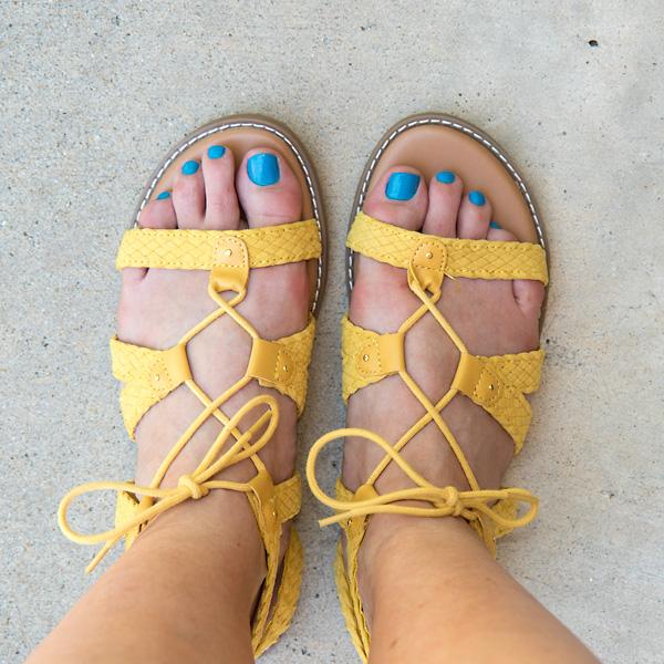 yellow sandals and blue nail polish