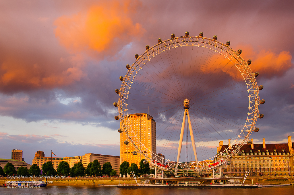 a photo of the london eye ferris wheel at sunset