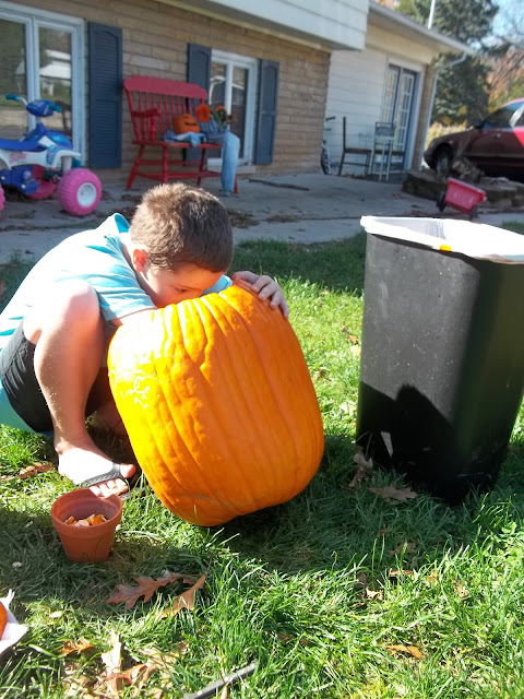 How to carve a pumpkin: Digging out pumpkin guts and seeds.