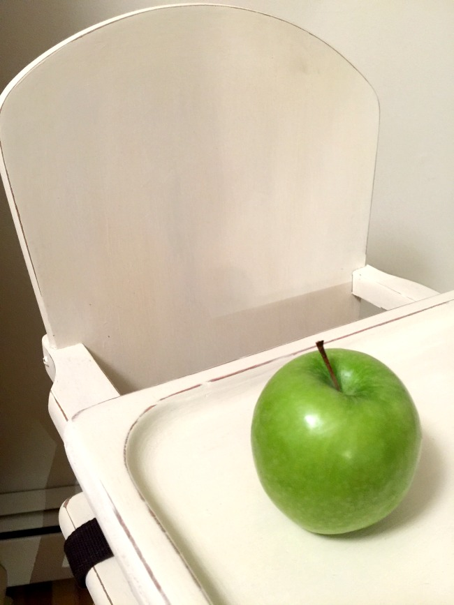Wooden chair and green apple
