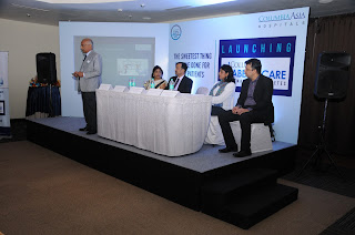 Photo 2: Dr. Nandakumar Jairam addressing the media