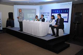 Photo 2: Dr. Nandakumar Jairam addressing the media