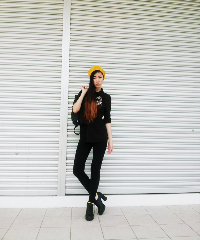 Brunei Fashion Blogger May Cho wearing all black, statement necklace, mustard beanie