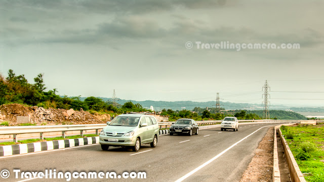 Tourists going to Shimla can now avoid congested Kalka and Pinjore towns to save at least an hour on their road trips with the opening of 10 kilometers long Himalayan Express bypass from Zirakpur to Parwanoo. The bypass, cutting through the Shivalik hills, is part of the 27.5 km expressway project between the two towns on NH-5  Though the stretch will reduce the distance between Zirakpur and Parwanoo by only three kilometers, but this bypass will save time and fuel in a big way. More important is about the fact that drive will be more pleasant through wonderful shivalik hills. Rough estimates suggest that tourists driving down from Delhi would now take seven hours to reach Shimla instead of eightHimalayan Expressway is built by Jaypee group. This road runs two kilometers in Punjab, 21km in Haryana and 4.5kms in Himachal Pradesh catering to about 30K vehicles passing through the stretch everyday. Commuters would need to pay Rs. 21 as toll for each trip on the stretch. Eventually, all the lanes would be having an RFID reader, which would be able to read from the chip embedded on the windshield of the vehicle and deduct balance from the users account. It seems Jaypee group would start issuing tags to commuters soon at a rate of about Rs.100, which is expected to come down as demand increasesDrive on Himalayan Expressway is a wonderful experience through Shivalik hills and this experience becomes more beautiful with clouds around these hills. Drive on Himalayan Expressway is like a surprise for folks who have been driving in planes and suddenly chip into the Shivalik hills.Here is a photograph of Himalayan Expressway passing through Pinjore town. This is not exactly Pinjore town but it's outer partFour-laning Himalayan Expressway of Zirakpur-Parwanoo stretch is a part of the National Highway Development Project. Jaiprakash Associates  was mainly responsible for Himalyan Expressways  Himalayan Expressway has become very useful for Chandigarh folks who love to visit Kasauli, Solan or Shimla during weekends. Now frequent travllers need not to experience the irritating traffic in Kalka streets.