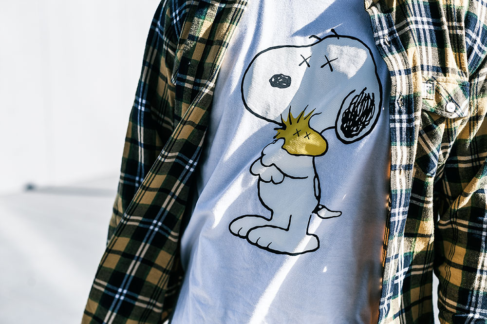 Fallen Footwear Flannel Shirt / Uniqlo X KAWS X Peanuts 'Snoopy & Woodstock' Tee by Tom Cunningham