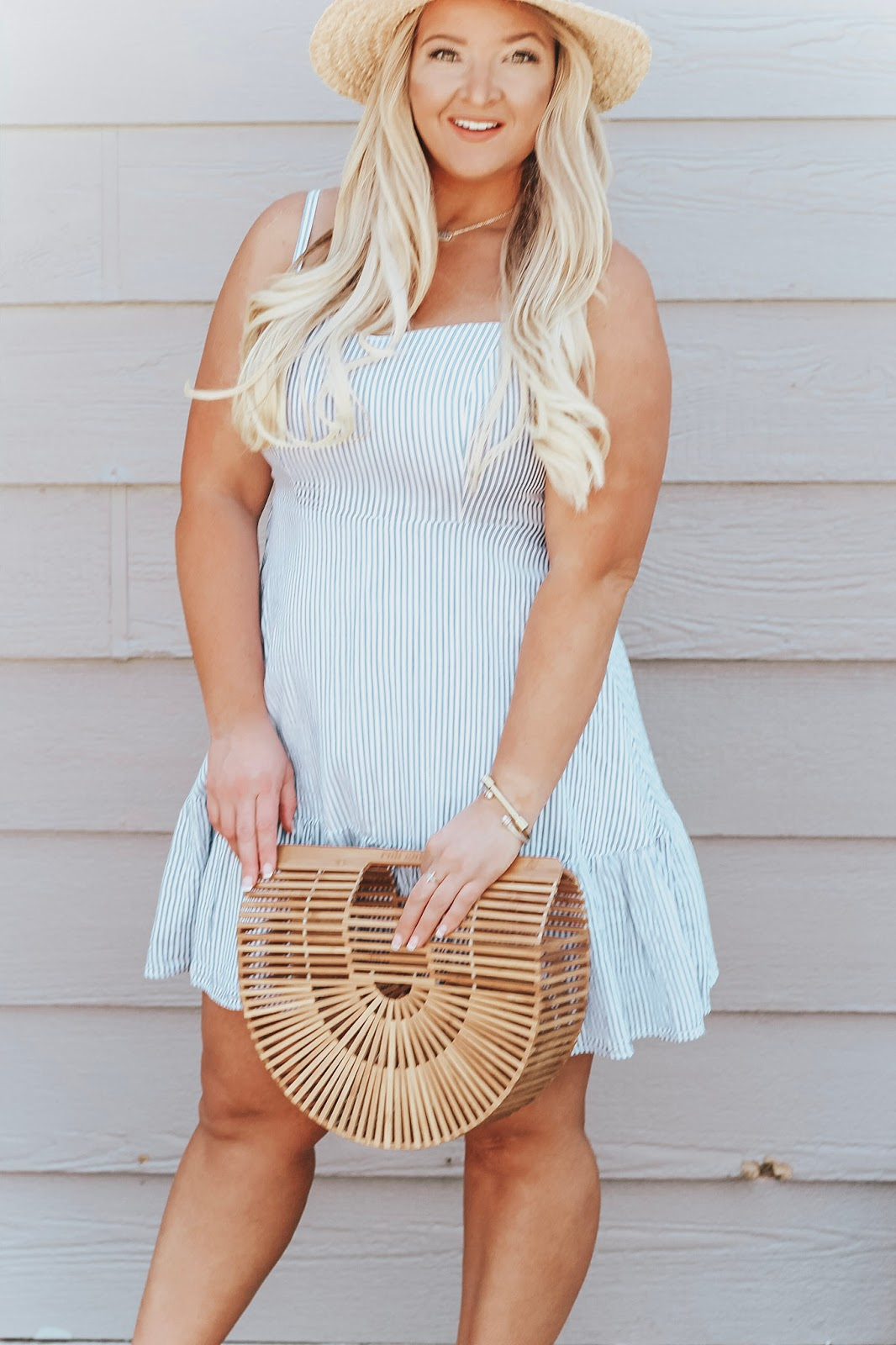 A Cute Striped Summer Dress for Independence Day featured by popular Denver fashion blogger, Delayna Denaye