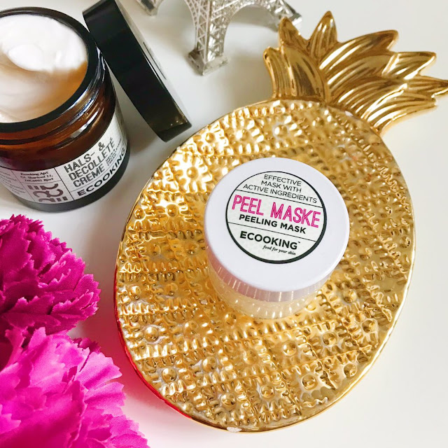 ECooking Skincare peeling mask on top of pineapple trinket dish. Neck and face cream next to it