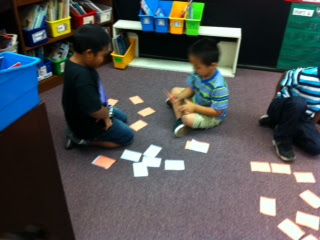 Partner students in classroom playing learning games