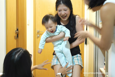 Baby Playing with Ninangs