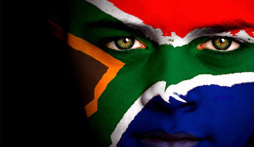 Freedom day. Boy with face painted as the new South African flag