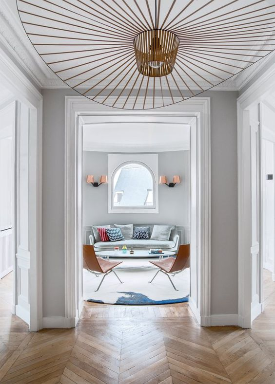 entry way with chevron floors grey walls and vertigo pendant by constance guisset & Vertigo Pendant Lamp by Constance Guisset: A Statement Lighting |