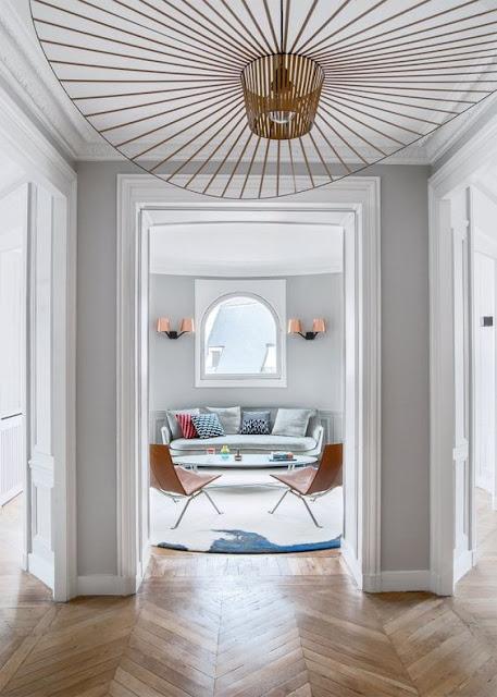 entry way with chevron floors, grey walls and vertigo pendant by constance guisset