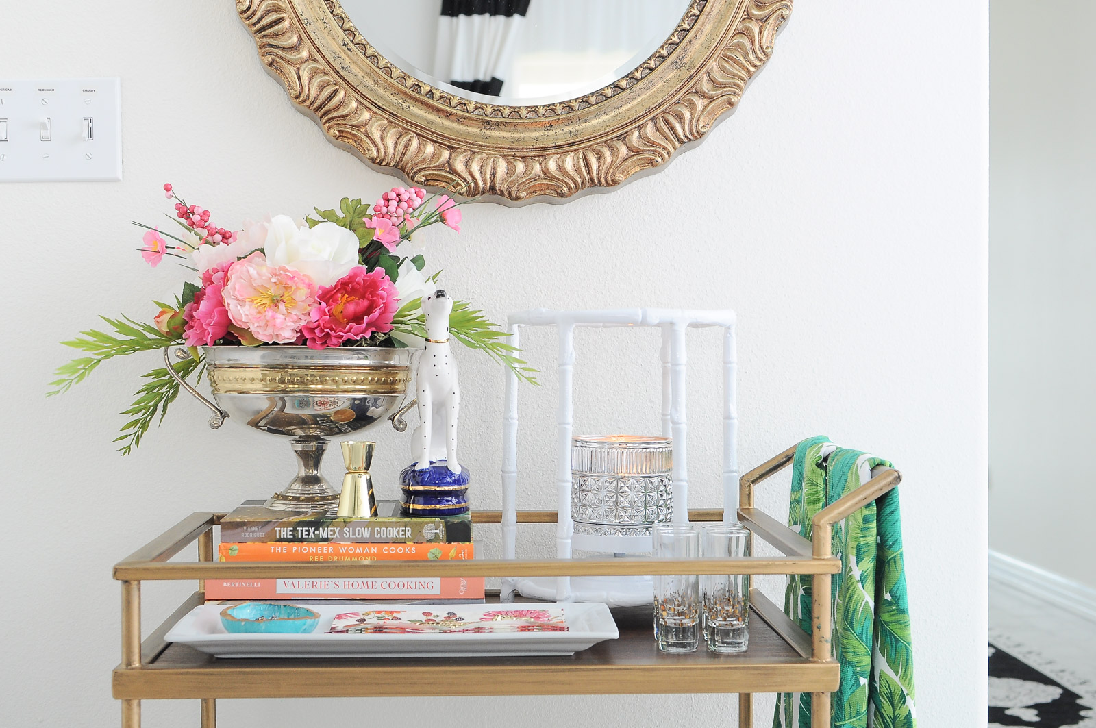 Spring bar cart decorating ideas using florals, gold accents, and chinioserie inspired elements.