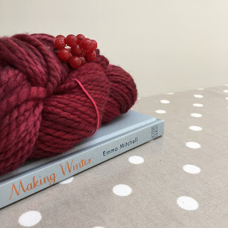 Making Winter book by Emma Mitchell and a skein of yarn